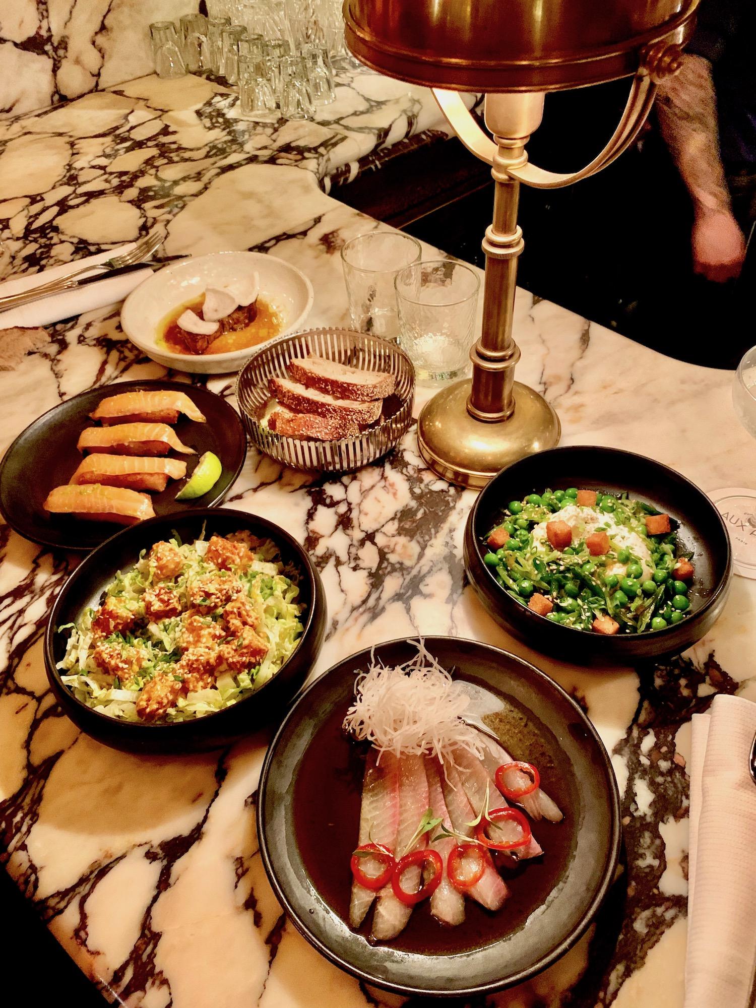 assortment of appetiers at cyril lignac's aux prés
