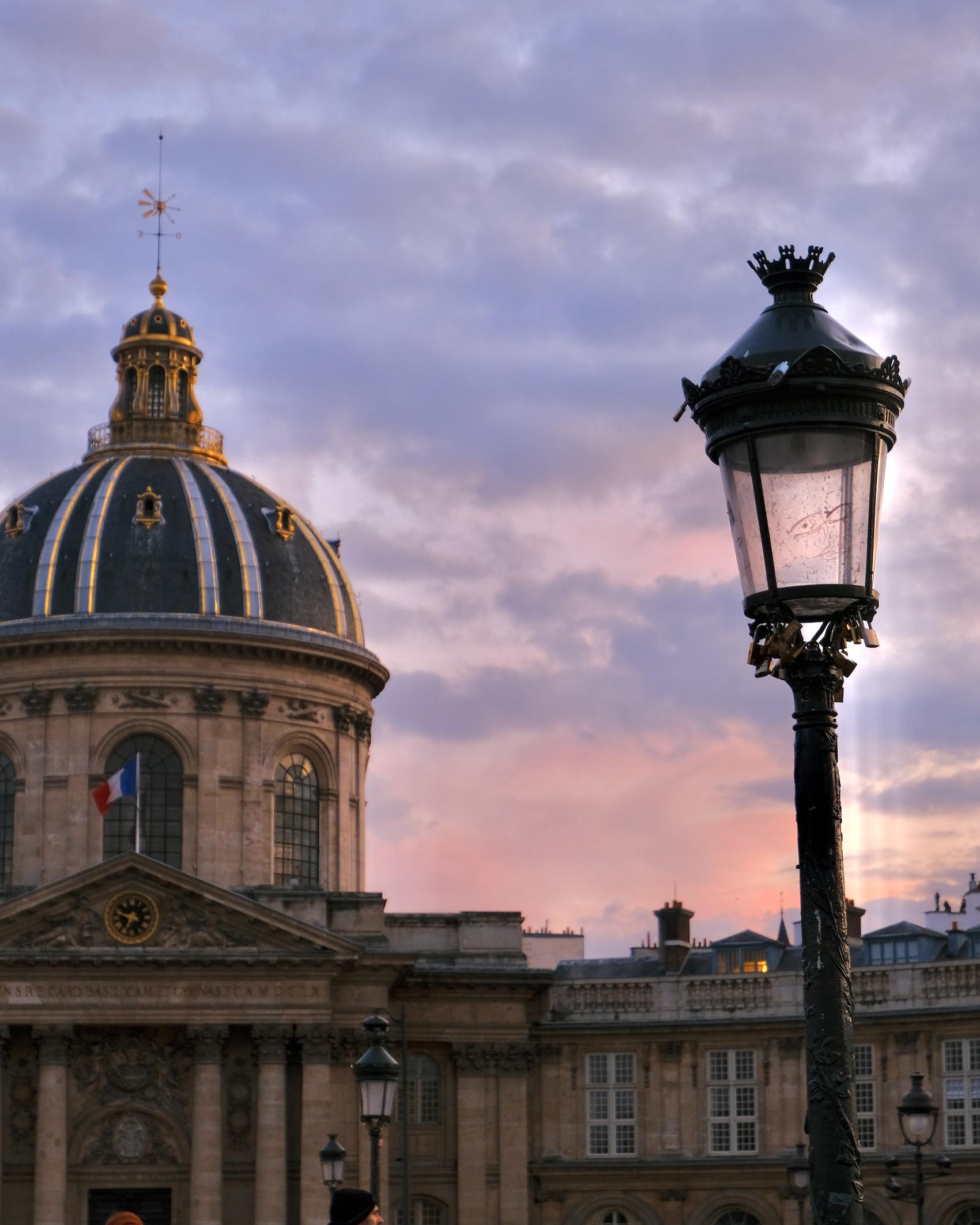 Five Reasons to Take a Solo Trip To Paris Pont Des Arts Sunset