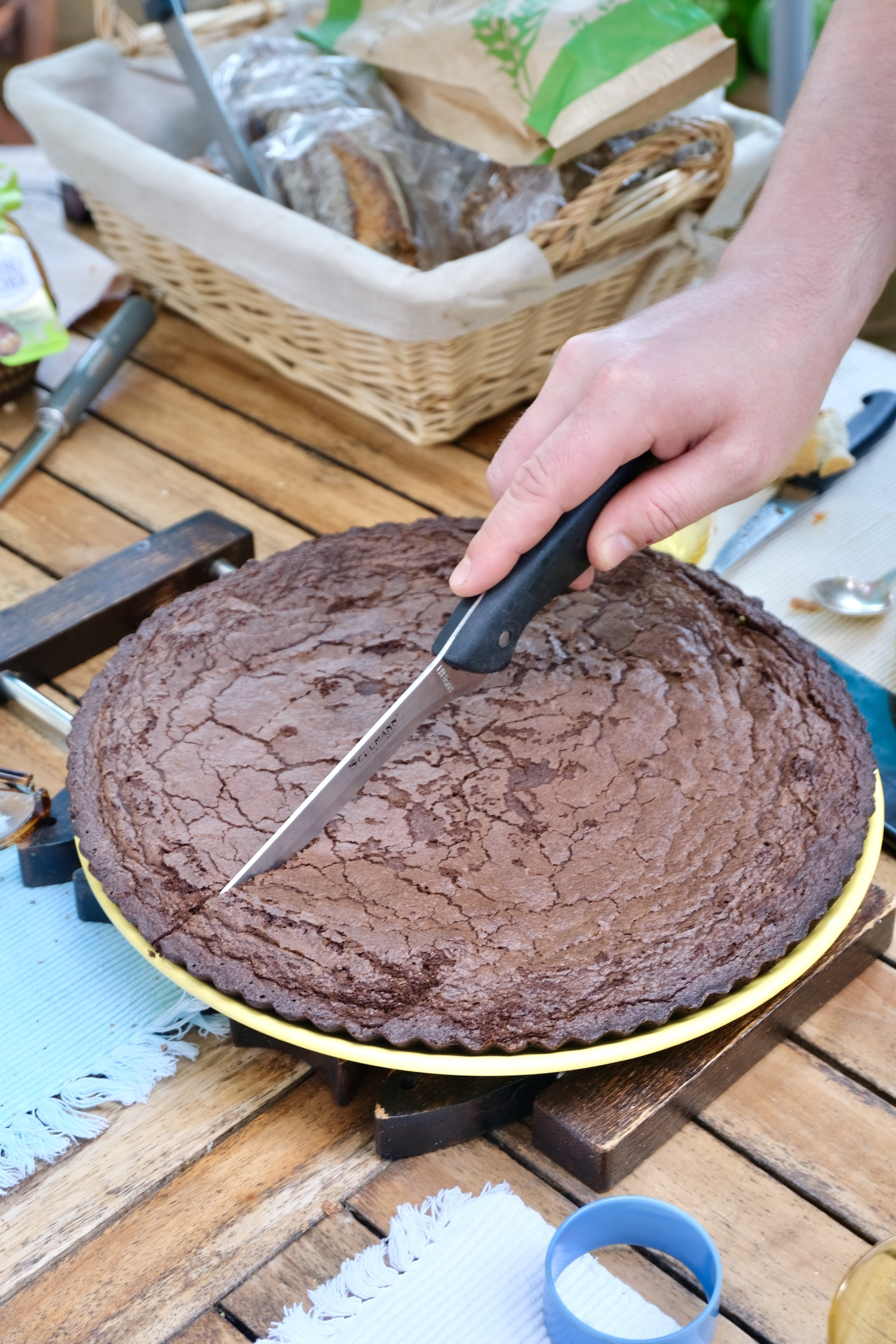 Cutting the Pierre Hermé Gâteau Suzy chocolate cake
