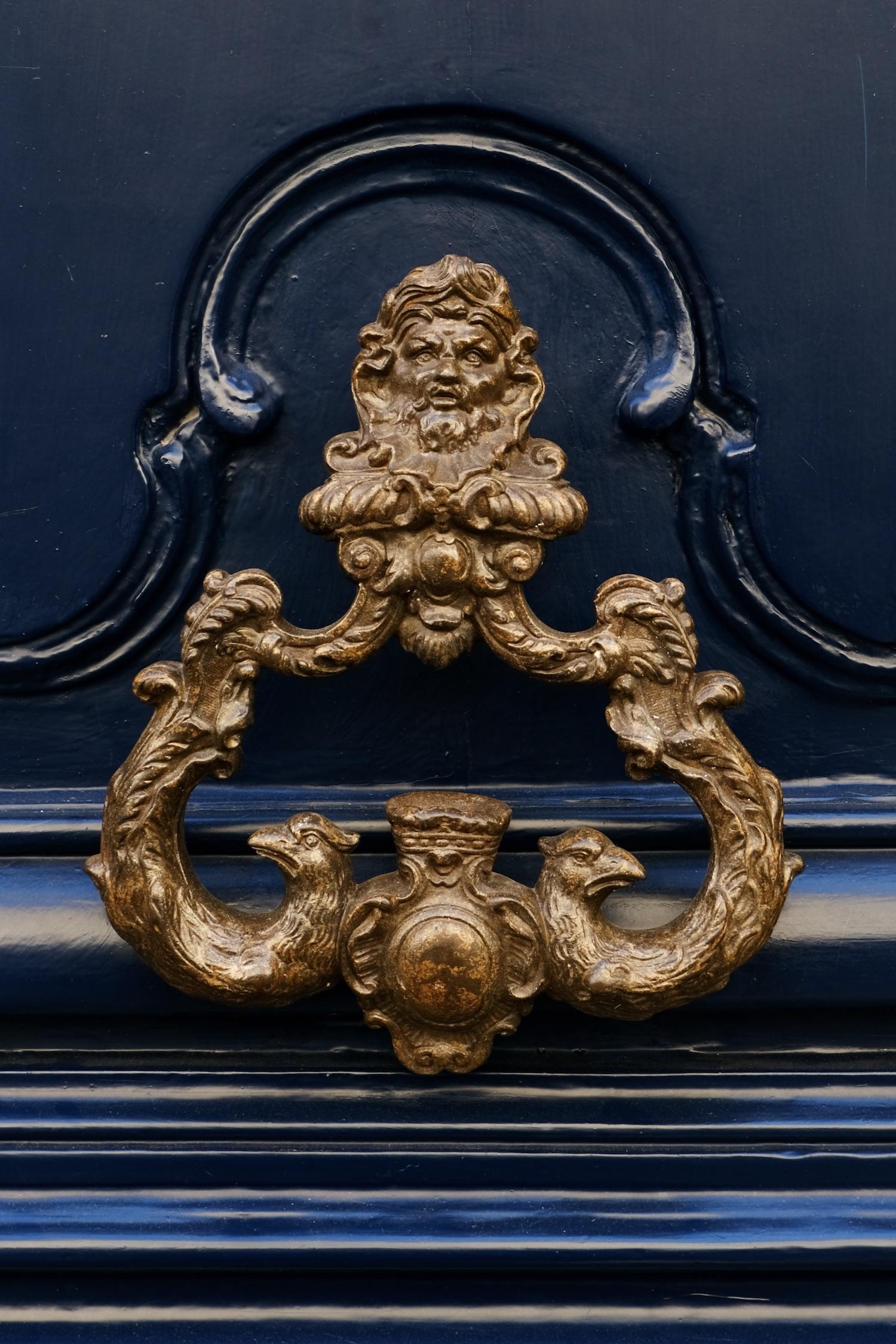 Door knocker on a dark blue door in Paris