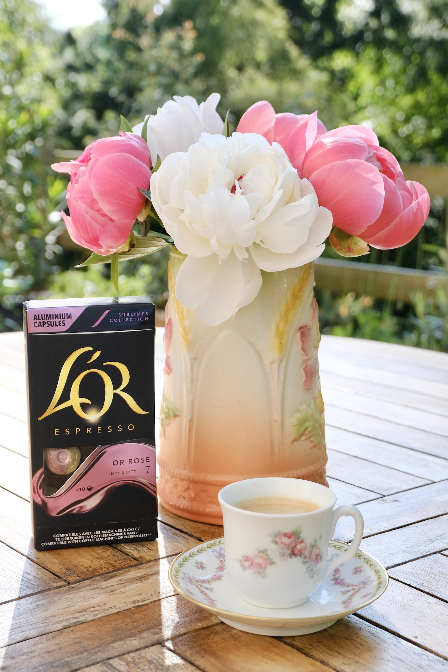 Rose espresso capsules with peonies and an antique espresso cup