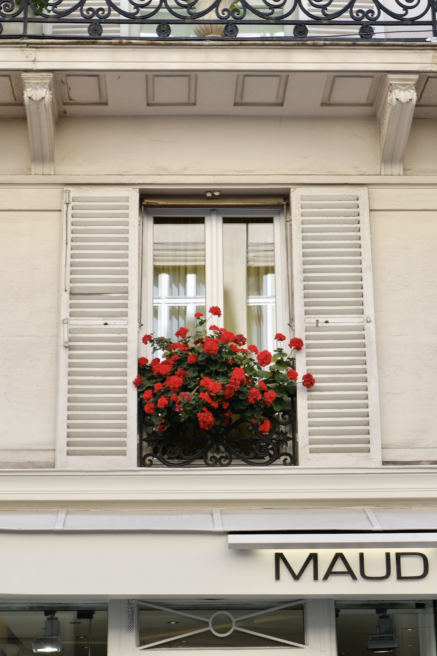 Paris window box with red geraniums