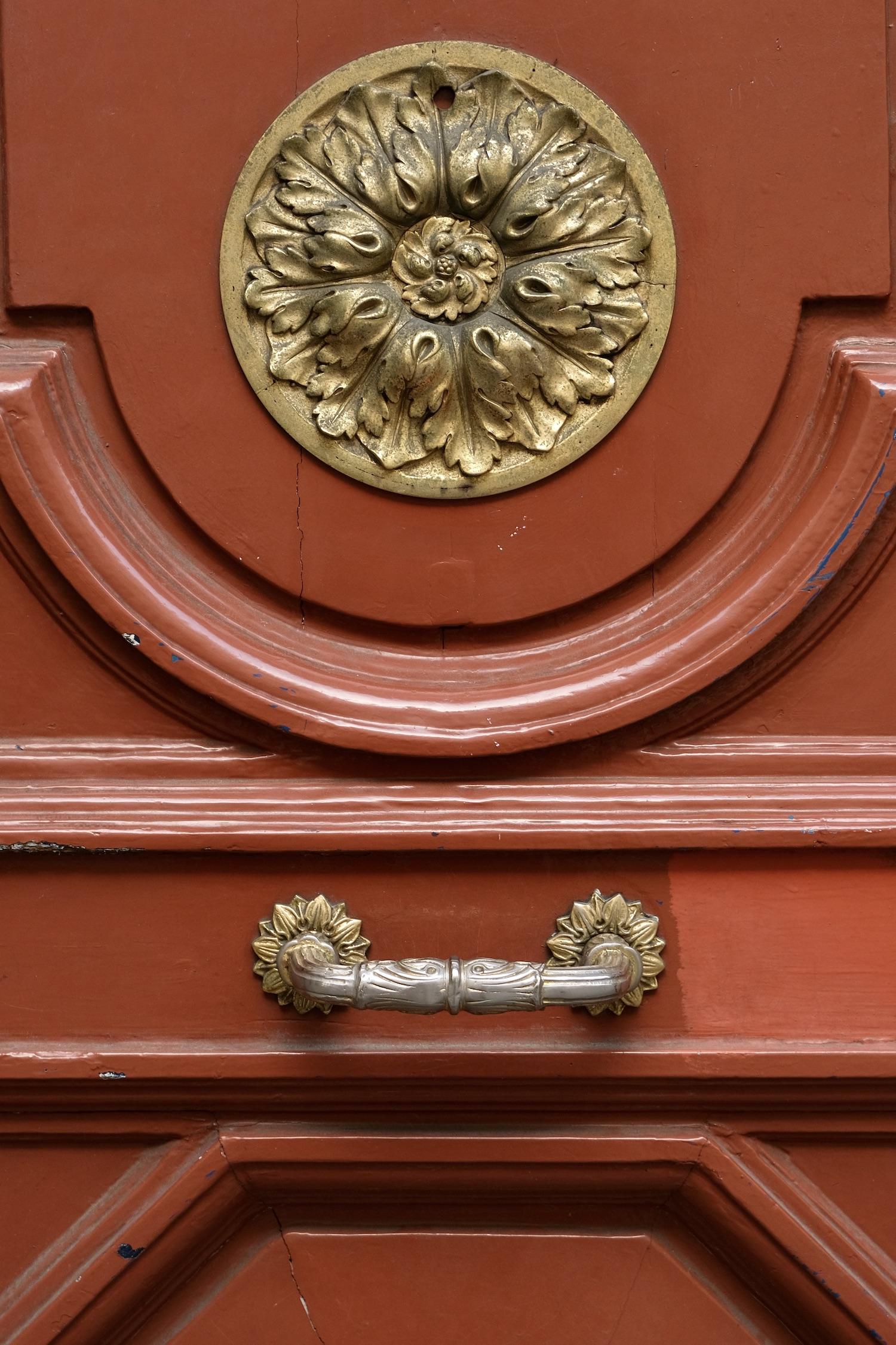 Orange door detail in Paris