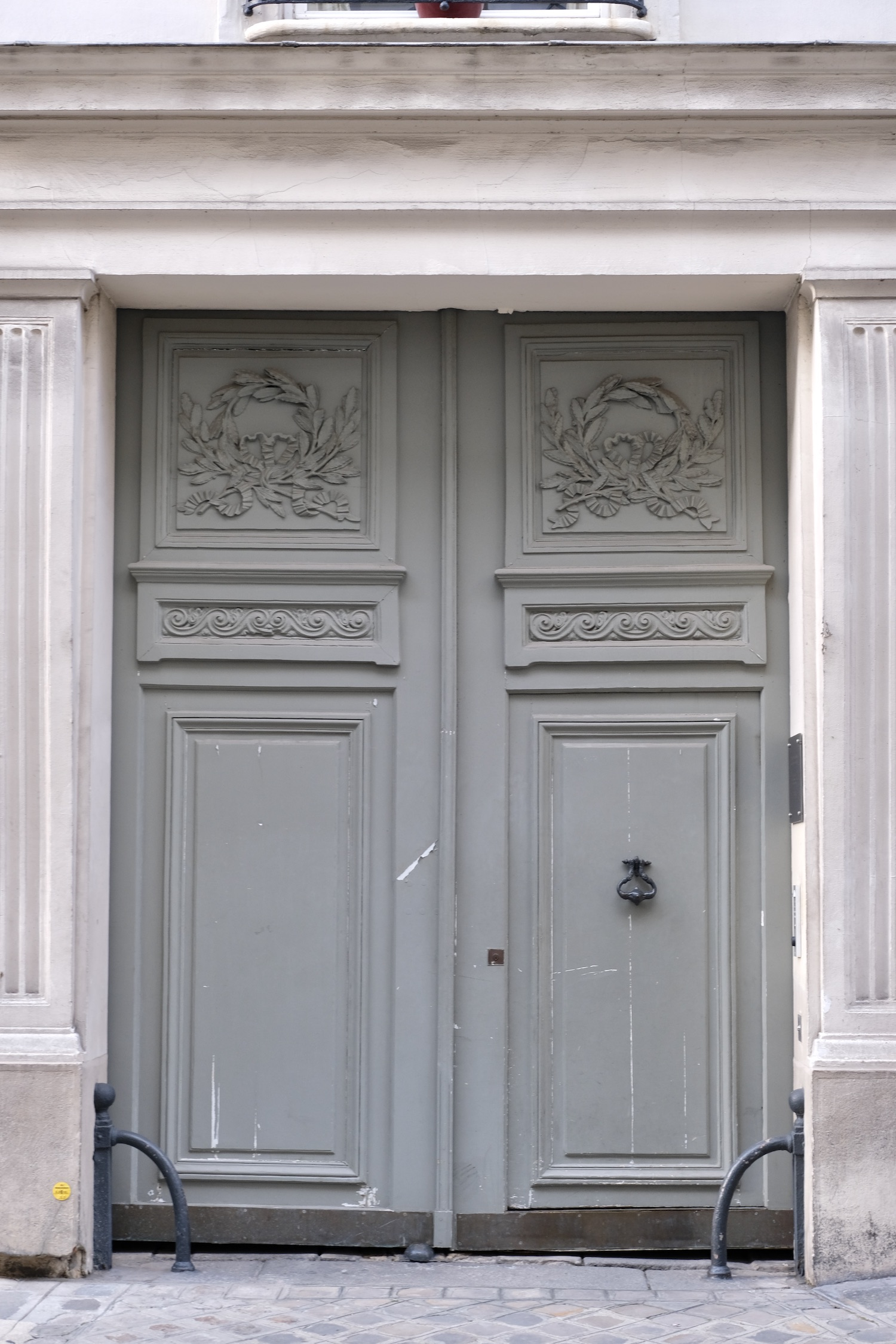 Grey door on Rue de Lille in Paris