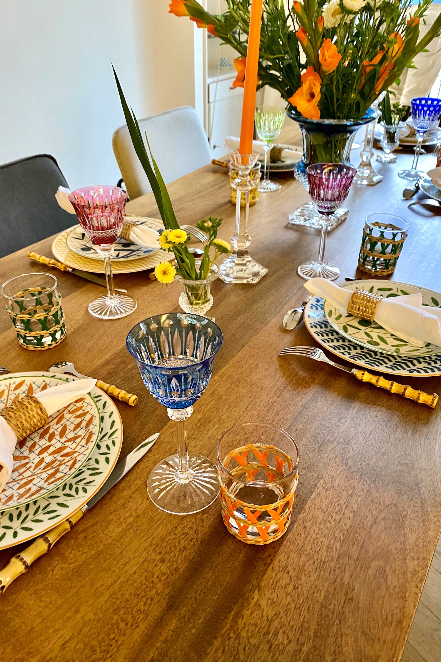 festive summer table with saint louis crystal and hermès plates