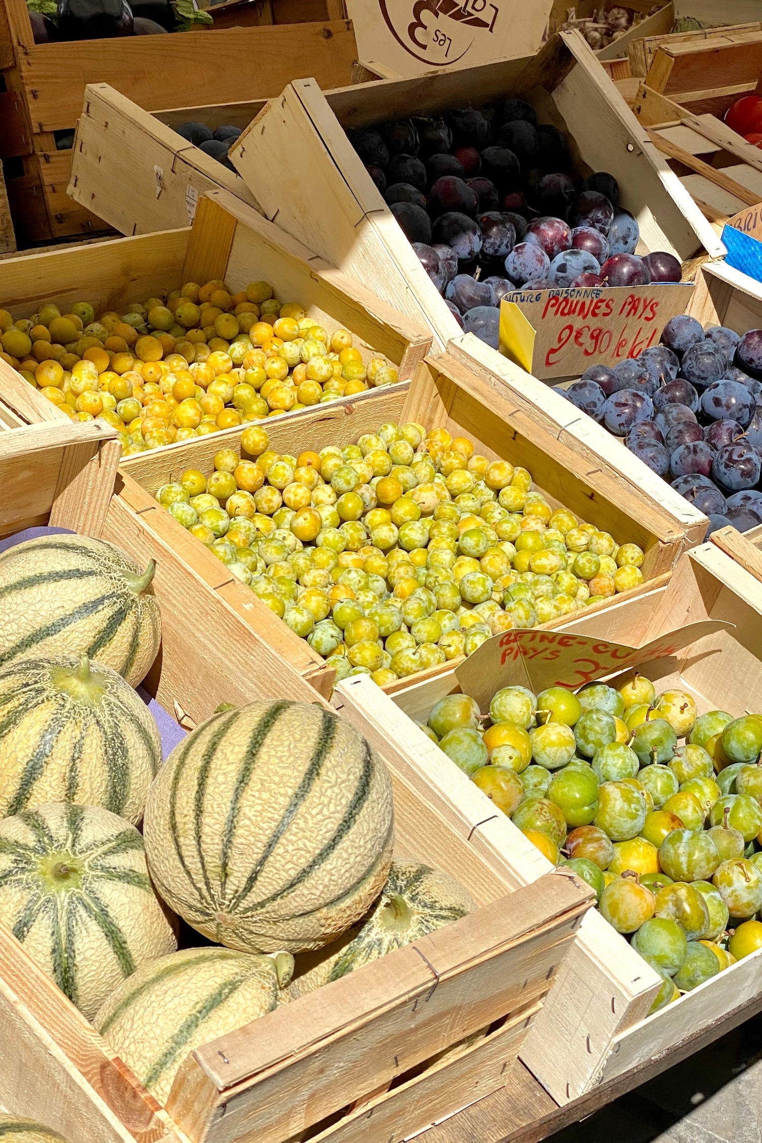 prunes and melons at the Mèze market