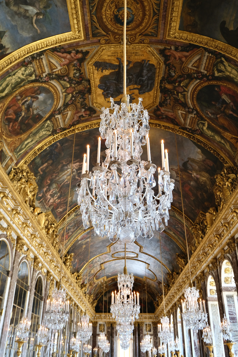 visiting château de versailles in the fall hall of mirrors chandeliers