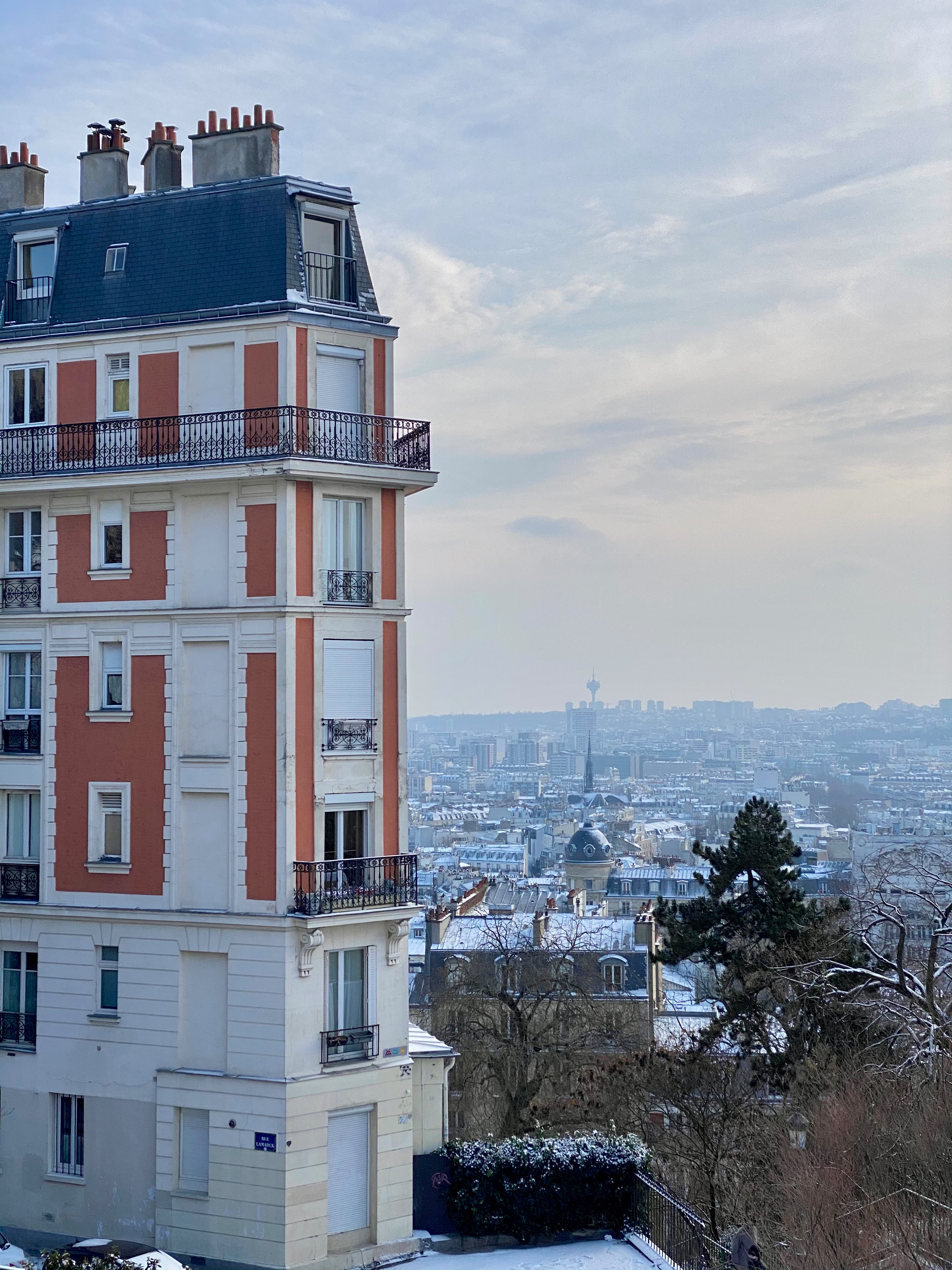 red building snow in montmartre