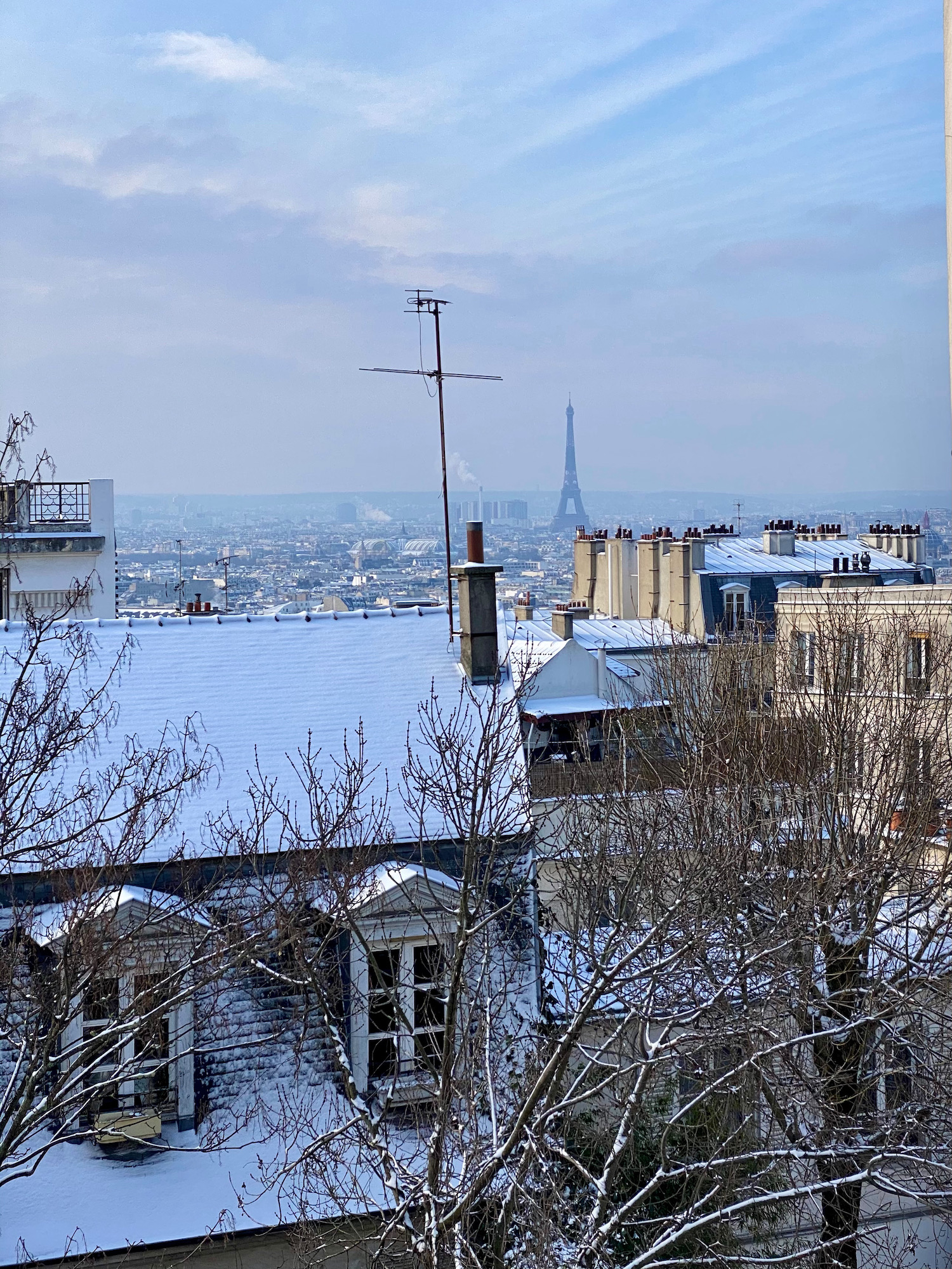 snow in montmartre eiffel tower view