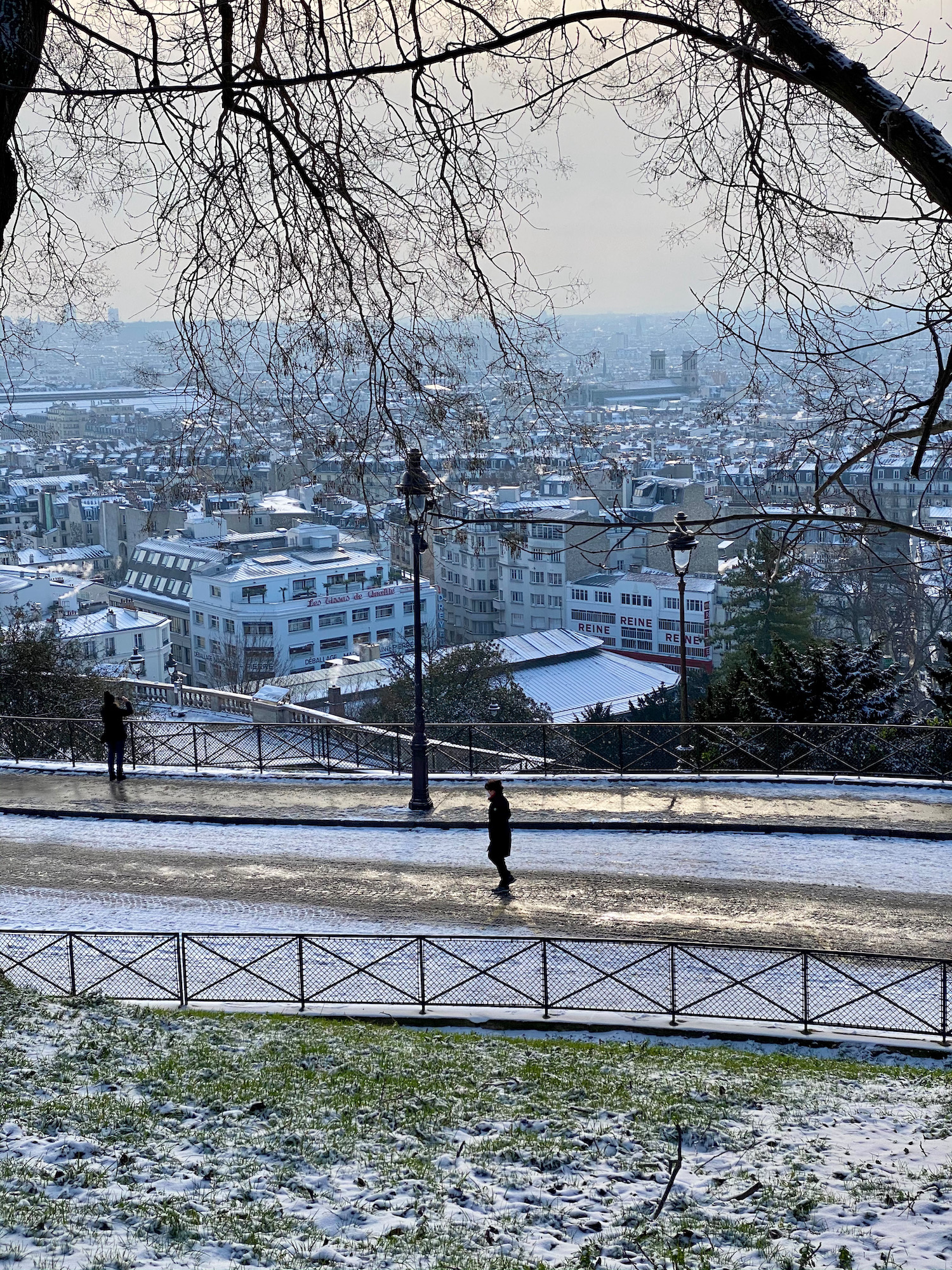 person walking in the snow in montmartre