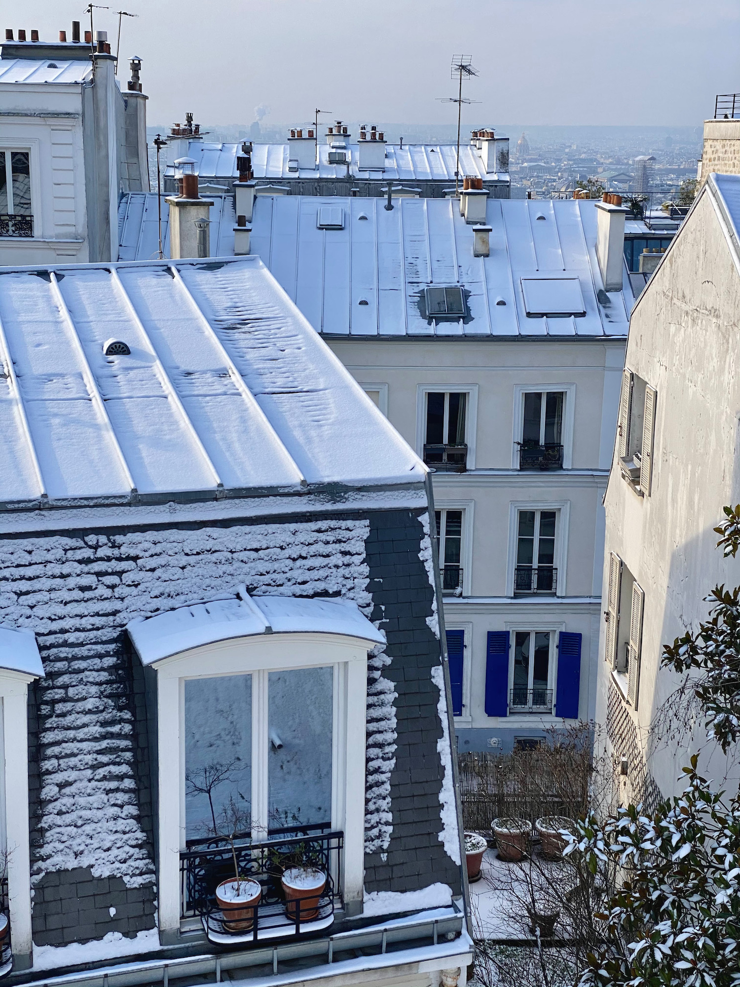 parisian rooftops covered in snow