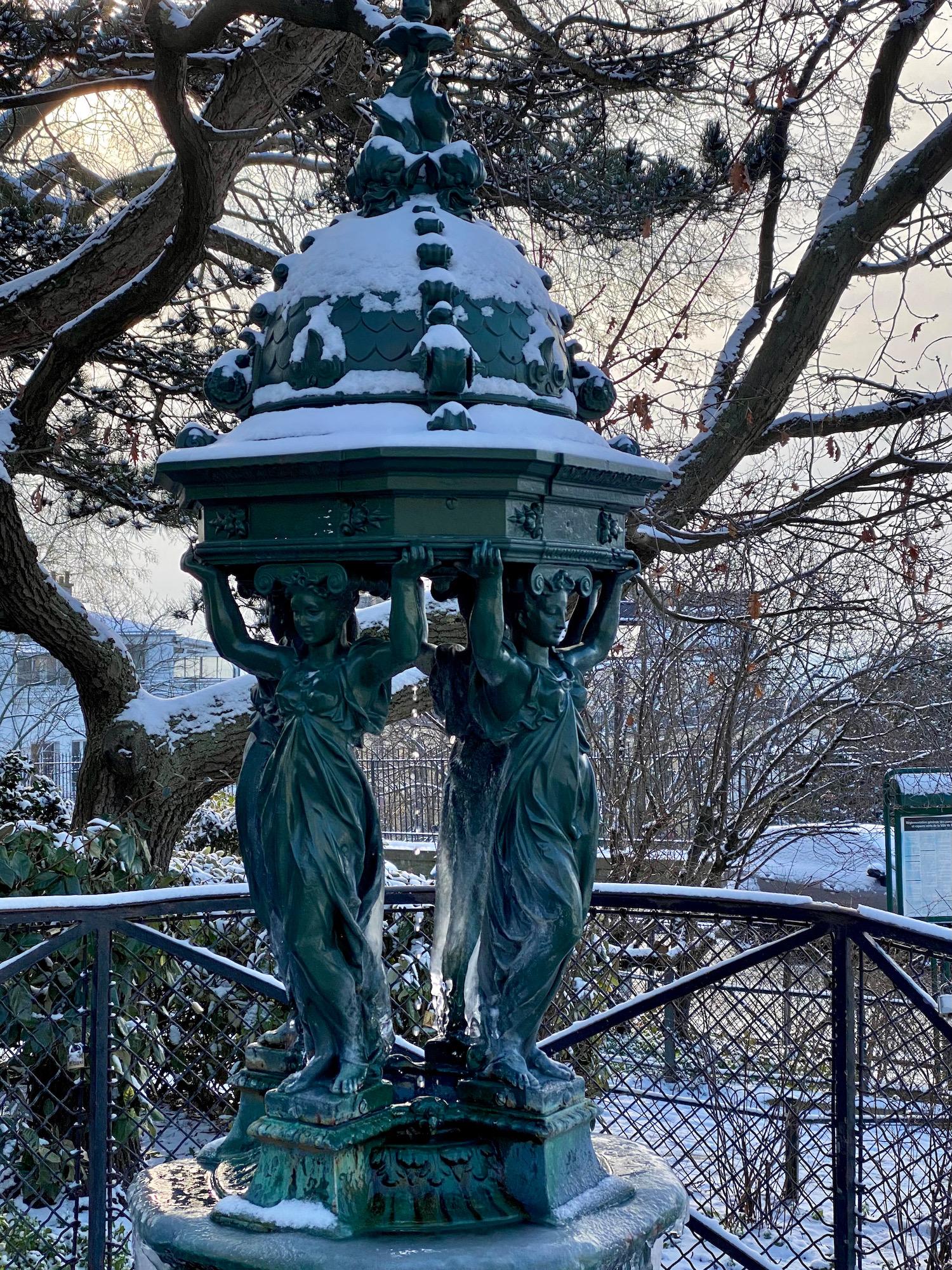 frozen wallace fountain in montmartre