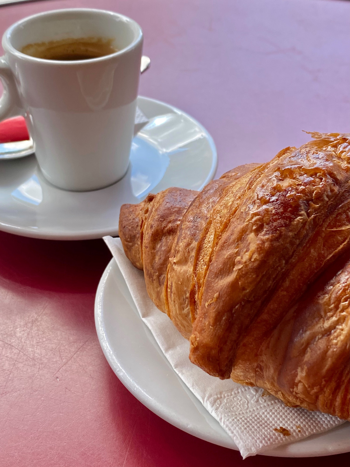 coffee and croissant on a terrasse in paris
