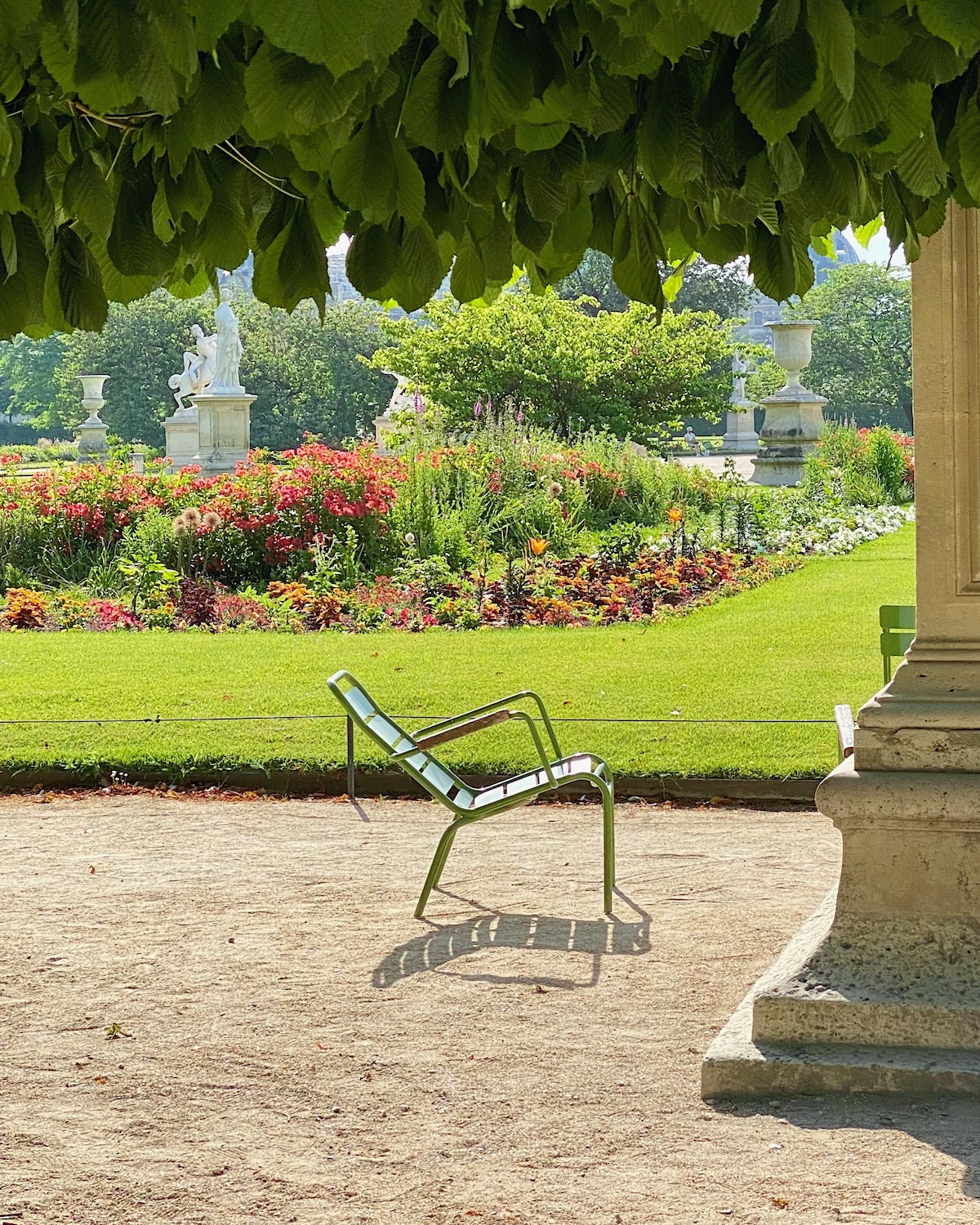 summer chair in the tuileries five friday finds from france featuring best thermal water sprays and statue of liberty replicas in paris