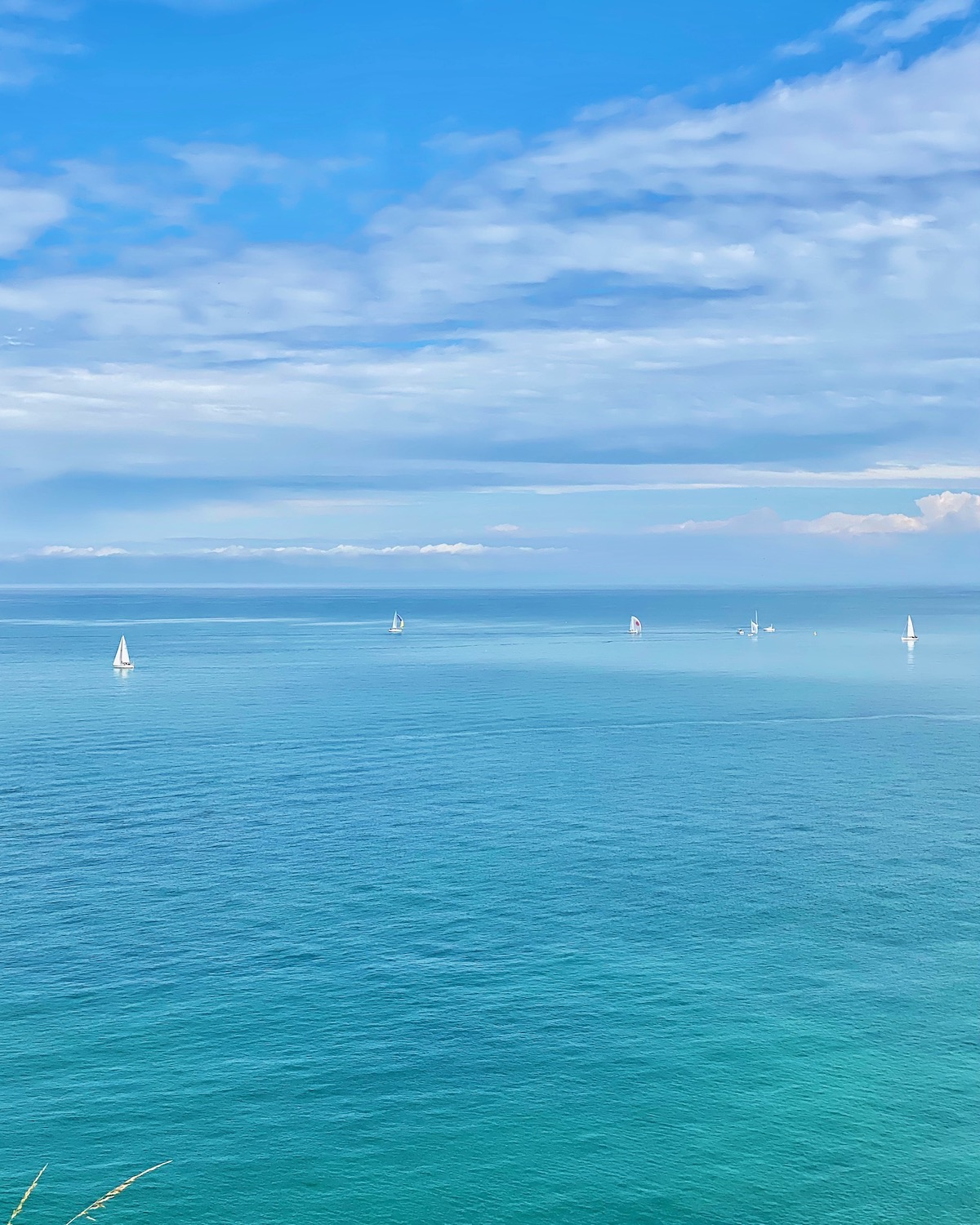 sailboats in granville normandy. five friday finds from france features la french seltzer by setsun, dior en roses exhibit and  the fête des tuileries