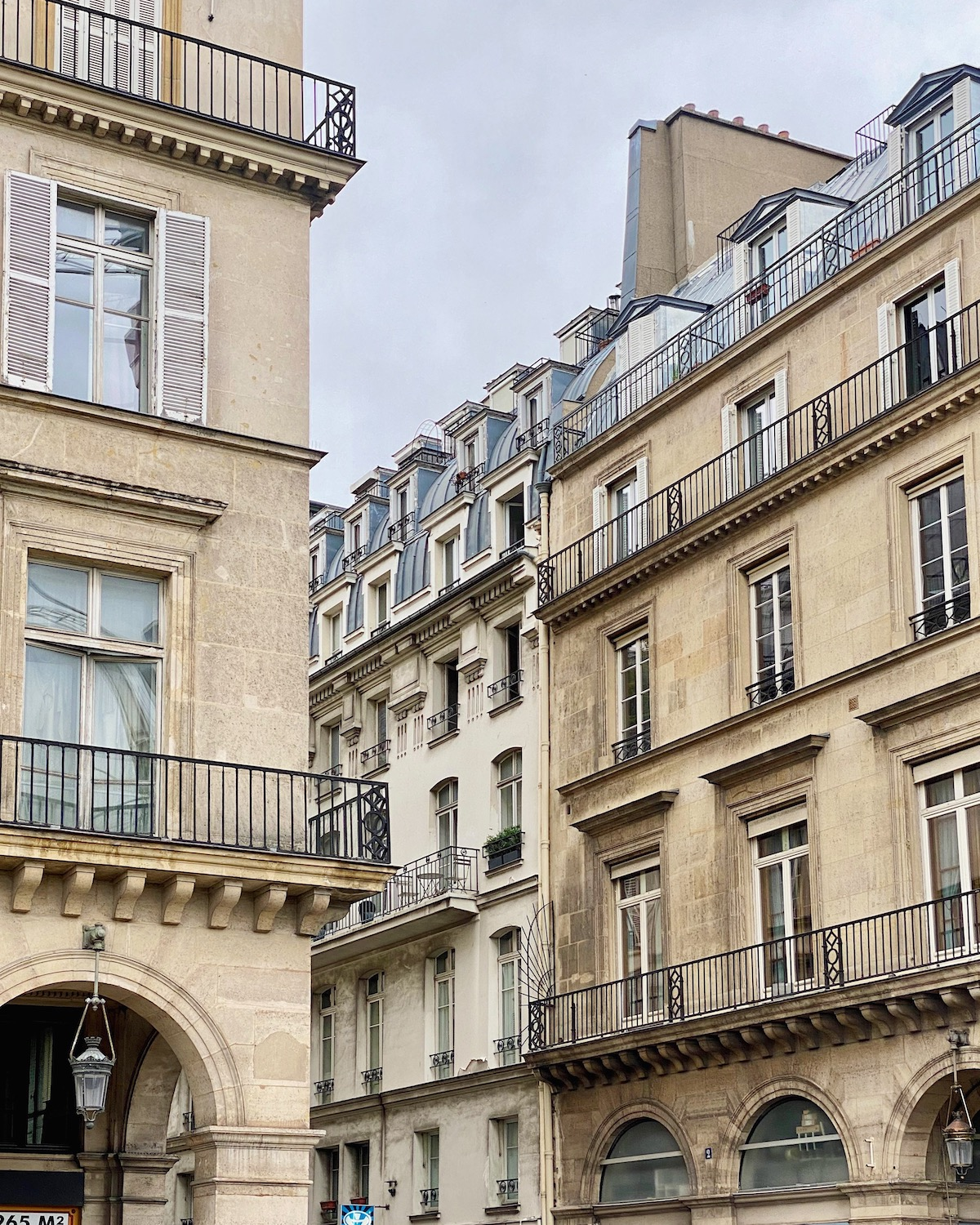 grey paris rue de rivoli. five friday finds from france featuring the new miss dior: a story of courage and couture book, a day trip from paris to cabourg, and french vibes club on instagram