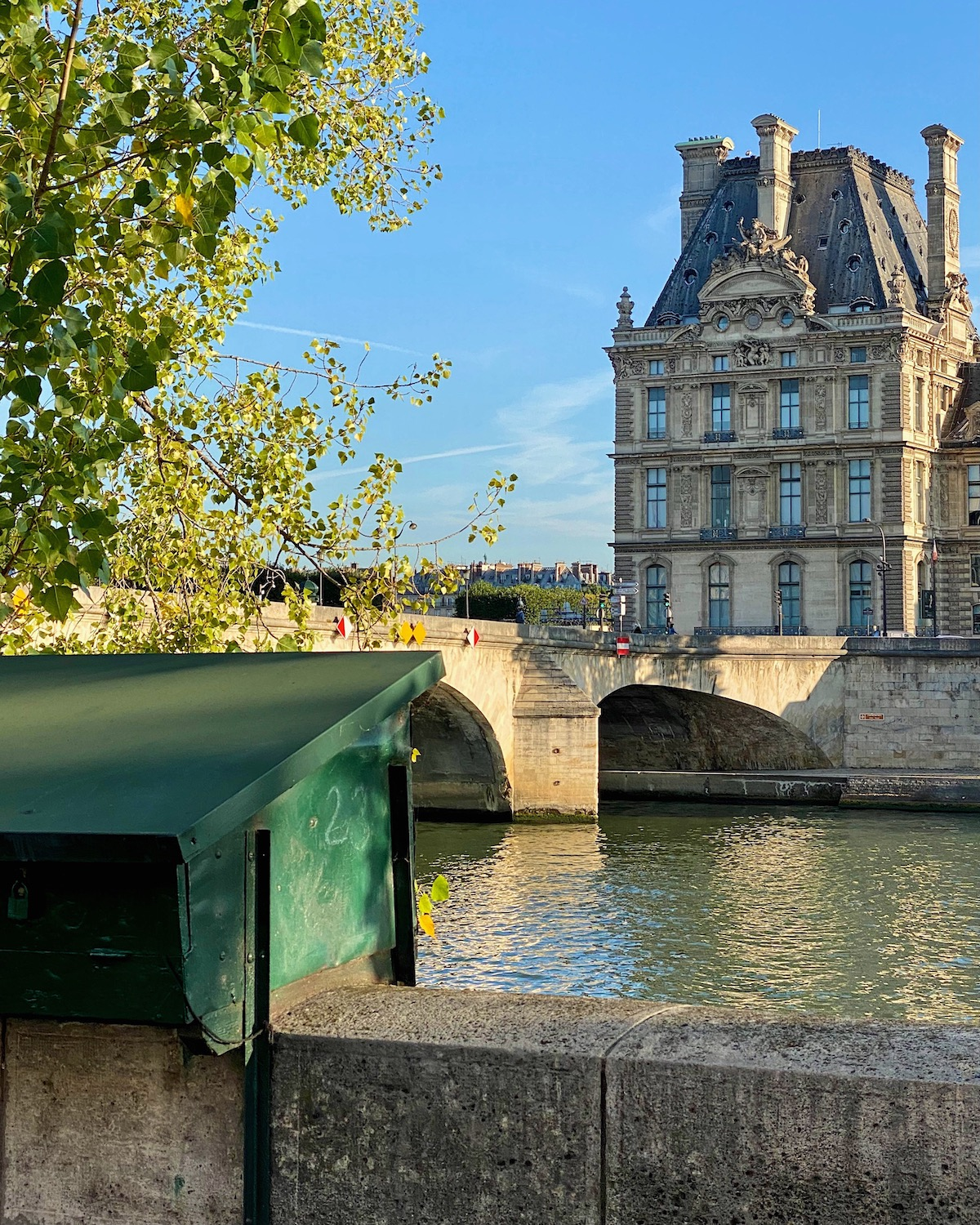 view of the louvre from quai voltaire