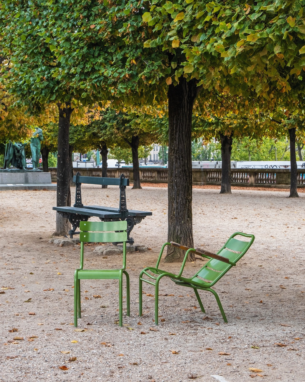 september in the tuileries two green chairs